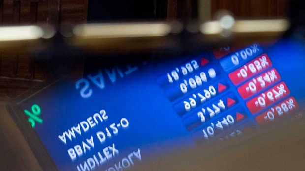 North American stocks split as fiscal cliff looms