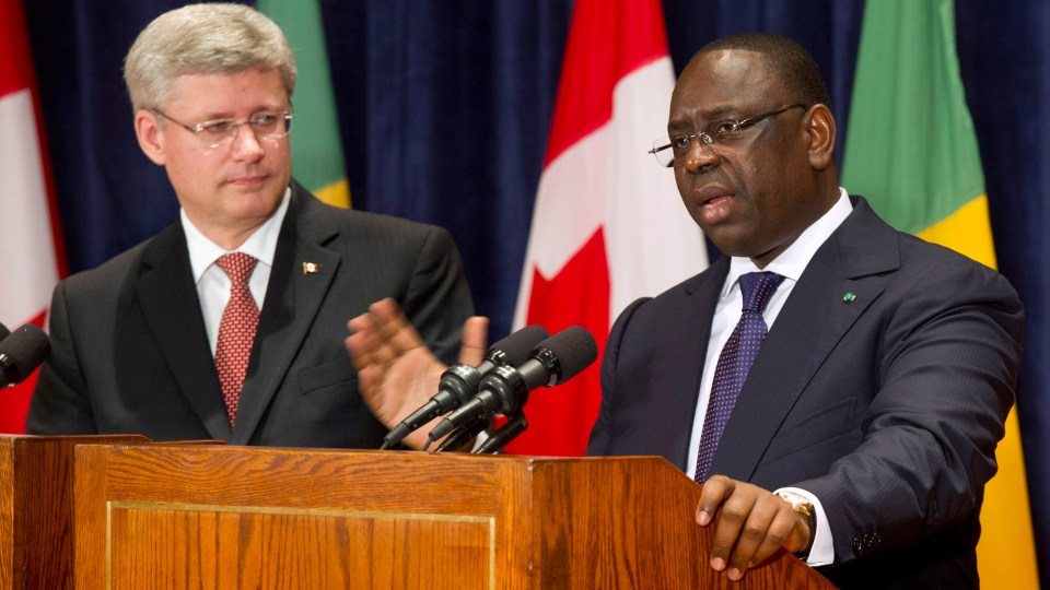 Prime Minister Stephen Harper listens to Senegal President Macky Sall during a joint news conference Friday, October 12, 2012 in Dakar, Senegal. (Paul Chiasson / THE CANADIAN PRESS)