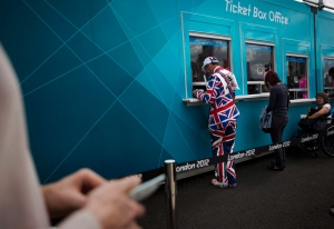 Visitors buy tickets for the Olympic Park at the 2012 Summer Olympics in London in this July 2012 file photo. (AP / Emilio Morenatti)