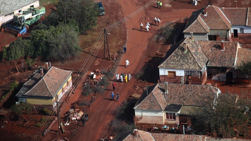 An aerial view of rescue team members walking in a street in Devecser, 164 km southwest of Budapest, Hungary, Friday, Oct. 8, 2010. (MTI / Balazs Mohai)