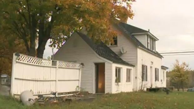 Police say two dead dogs, a dead rabbit, and a malnourished cat were found inside this home in Harvey Station, N.B. in September.