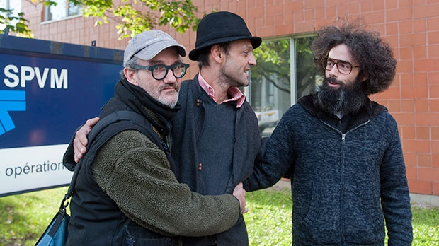 From left, Serge Lavoie, Rudi Ochietti and Simon Page pose for a photo outside a police operational centre in Montreal, Friday, October 12, 2012. (Graham Hughes / THE CANADIAN PRESS)