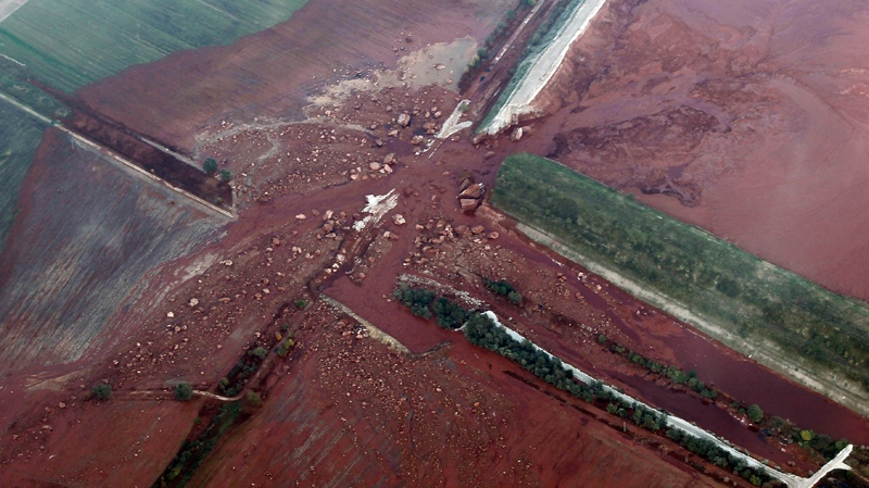 The damaged reservoir near an alumina plant is seen from the air, in Kolontar, Hungary, Friday, Oct. 8, 2010. (AP / Darko Bandic)