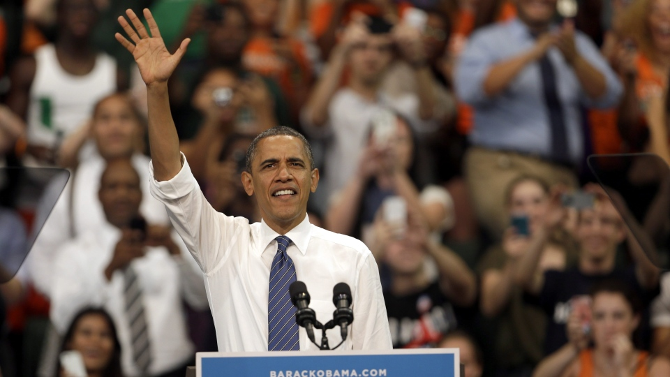 U.S. President Barack Obama waves as he arrives at a campaign event at the University of Miami in Coral Gables, Florida, Thursday, Oct. 11, 2012. (AP / Lynne Sladky)