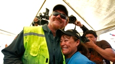 Jeff Hart, the T-130 drill operator from Denver, Colorado, embraces Elizabeth Segovia, sister of trapped miner Dario Segovia Rojo at the San Jose mine near Copiapo, Chile Saturday, Oct. 9, 2010. (AP / Roberto Candia)
