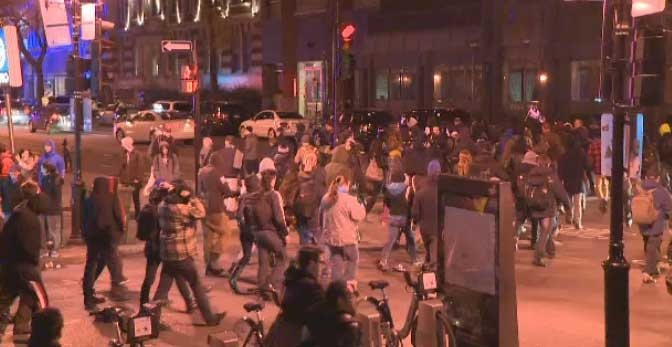 About 100 people walked through the streets of Montreal Friday to demand the firing of officer 728.