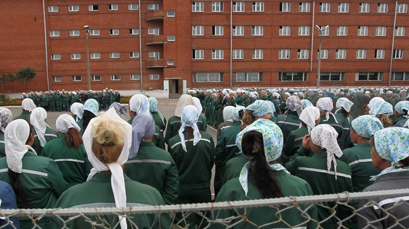 In this photo taken Aug. 22, 2012 imprisoned women stand during a morning inspection at a women's prison in a town of Sarapul, central Russia.  (AP Photo/Yuri Tutov)
