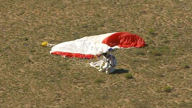 Pilot Felix Baumgartner safely lands after skydiving from the stratosphere, in southwestern New Mexico, Sunday, Oct. 14, 2012.