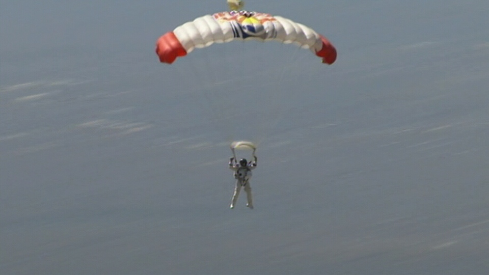 Felix Baumgartner parachutes to safety after skydiving from the stratosphere, in southwestern New Mexico, Sunday, Oct. 14, 2012.