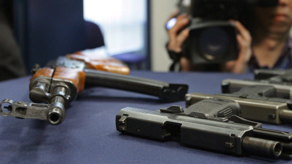 Weapons seized during several gang-related arrests are displayed during a police news conference in Vancouver, B.C., on March 6, 2009. (Darryl Dyck / THE CANADIAN PRESS)