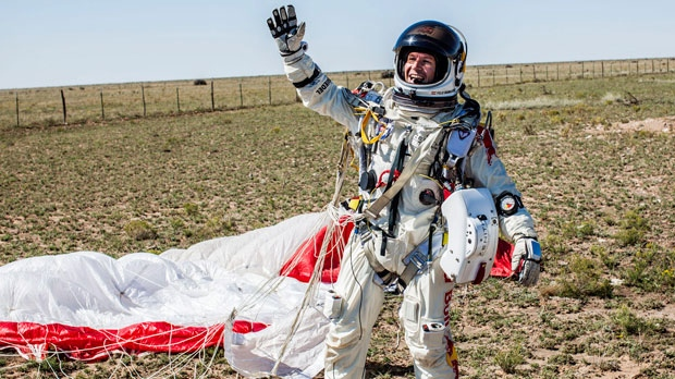 In this photo provided by Red Bull Stratos, Pilot Felix Baumgartner of Austria celebrates after successfully completing the final manned flight for Red Bull Stratos in Roswell, N.M., Sunday, Oct. 14, 2012.(AP Photo/Red Bull Stratos, Balazs Gardi)
