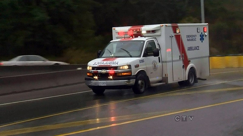 An ambulance rushes to the scene of a collision along the Malahat Highway near Victoria, Sunday, Oct. 14, 2012. (CTV BC)