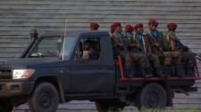 Truck carrying soldiers drives through Kinshasa