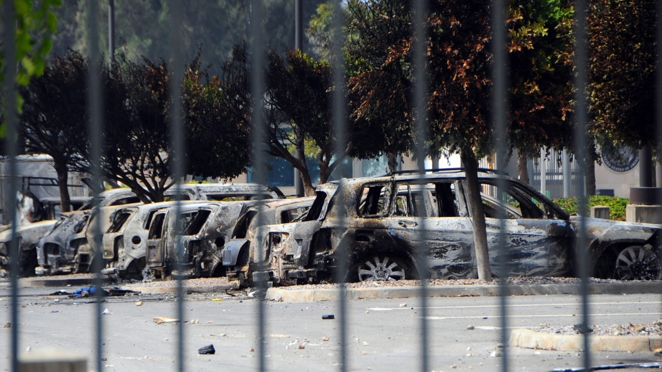 Several dozen burned cars remain in the parking lot of the U.S. Embassy, a day after several thousand demonstrators angry over a film that insults the Prophet Muhammad stormed the compound, Tunis, Tunisia, Saturday, Sept. 15, 2012. (AP / Hassene Dridi)
