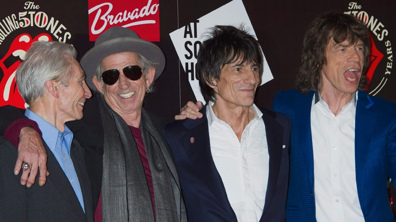 From left, Charlie Watts, Keith Richards, Ronnie Wood and Mick Jagger, from the British Rock band, The Rolling Stones, as they arrive at a central London venue, to mark the 50th anniversary of the Rolling Stones first performance, Thursday, July 12, 2012. (AP / Jonathan Short)