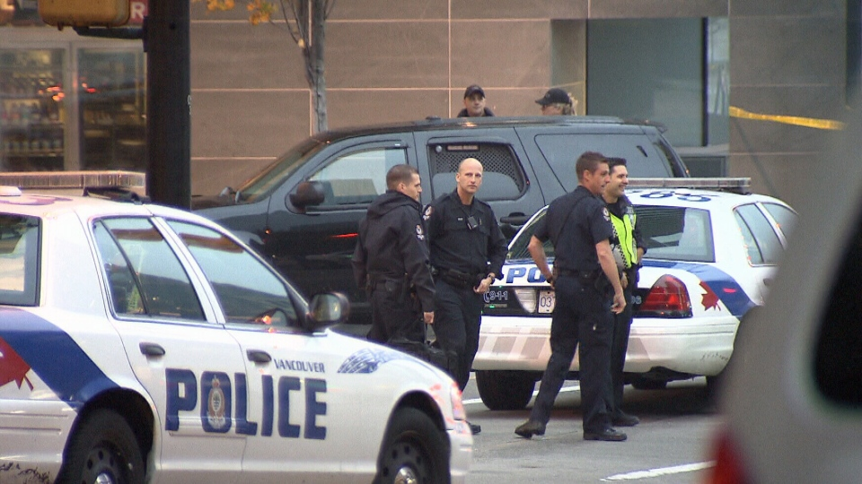 Police stand guard while officers negotiate with an armed man who allegedly entered the Fairmont Pacific Rim with a gun on Monday, Oct. 15, 2012. (CTV)