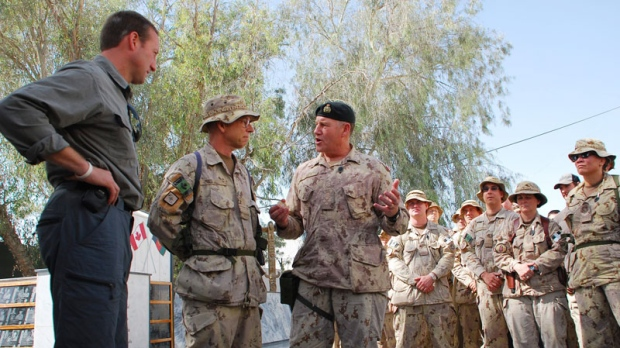 Defence Minister Peter MacKay (left) and Chief of Defence Staff Walter Natynczyk (centre) talk to Canadian soldiers in Kandahar, Afghanistan, Sunday, Oct.10, 2010. (Jonathan Montpetit / THE CANADIAN PRESS)