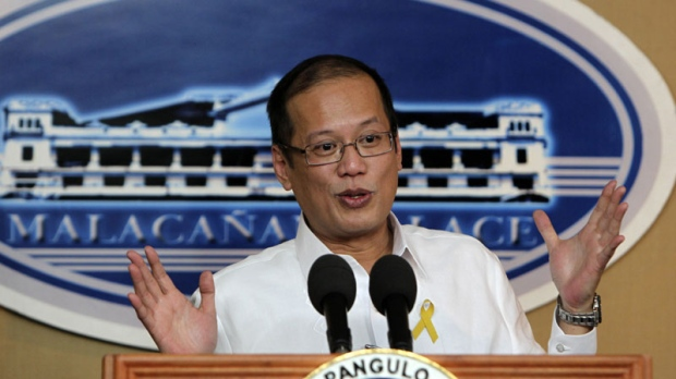 Philippine President Benigno Aquino III gestures as he announces in a news conference Monday Oct.11, 2010 at Malacanang Palace in Manila that top Philippine police and security officials will face only administrative sanctions for a bungled bus hostage rescue in August 23 that left eight Hong Kong tourists dead. (AP Photo/Bullit Marquez)