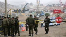 Police guard the entrance to the San Jose mine near Copiapo, Chile, Monday Oct. 11, 2010.  (AP / Jorge Saenz)