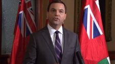 PC Leader Tim Hudak speaks to the media in Toronto