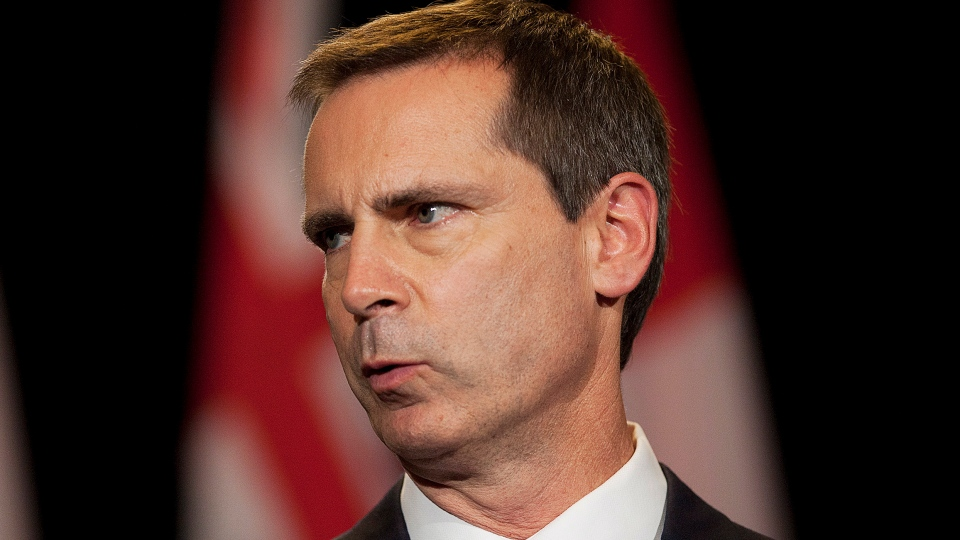 Ontario Premier Dalton McGuinty speaks to the media at Queen's Park after announcing his resignation in Toronto on Monday, Oct. 15, 2012. (Michelle Siu / THE CANADIAN PRESS)