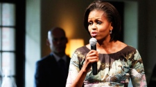 First lady Michelle Obama speaks to her guests during a luncheon at Stone Barns Center in Tarrytown, N.Y. , with the spouses of some of the chiefs of state attending the United Nations General Assembly, Friday, Sept. 24, 2010. (AP Photo/Mary Altaffer)