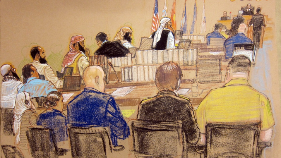 In this photo of a sketch by courtroom artist Janet Hamlin and reviewed by the U.S. Department of Defense, the five Guantanamo prisoners charged in the Sept. 11 attacks, back row from left, Mustafa Ahmad al-Hawsawi, Ali Abd al-Aziz Ali, Ramzi Binalshibh, Walid bin Attash and the alleged mastermind Khalid Sheik Mohammed, attend their Military Commissions pretrial hearing in the Guantanamo Bay U.S. Naval Base in Cuba on Monday, Oct. 15, 2012. (AP /Janet Hamlin)