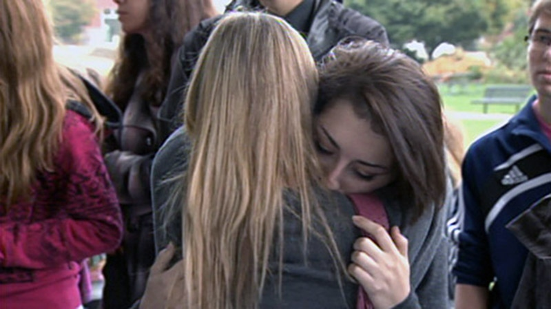 Friends of Amanda Todd hug at a memorial in Port Coquitlam, B.C. on Monday, Oct. 15, 2012.