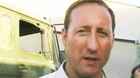 Defence Minister Peter MacKay speaks to reporters in Kandahar on Monday, Oct. 11, 2010.