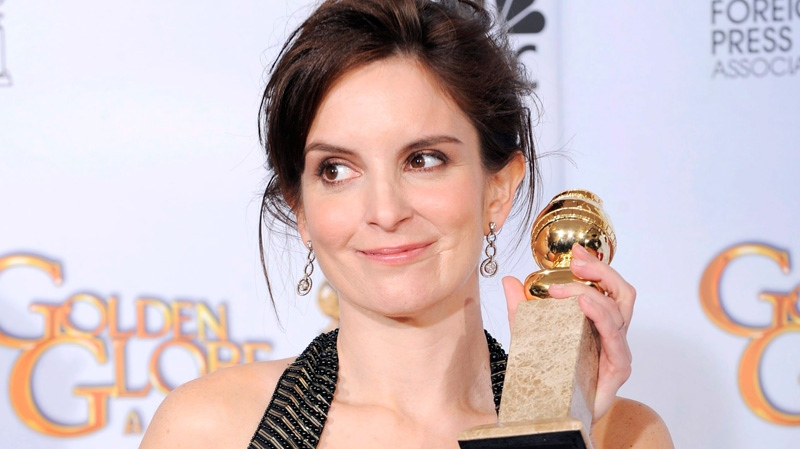 Tina Fey poses backstage with the award for best actress in a television series, comedy or musical for '30 Rock' at the 66th Annual Golden Globe Awards in Beverly Hills, Calif. in 2009. (AP / Mark J. Terrill, file)