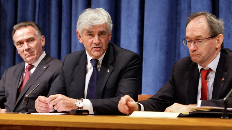 Foreign Affairs Minister Lawrence Cannon, centre, flanked by Peter Kent, minister of state for foreign affairs of the americas, left, and Canada's UN Ambassador John McNee, participate in a news conference at United Nations headquarters, Tuesday, Oct. 12, 2010. (AP / Richard Drew)