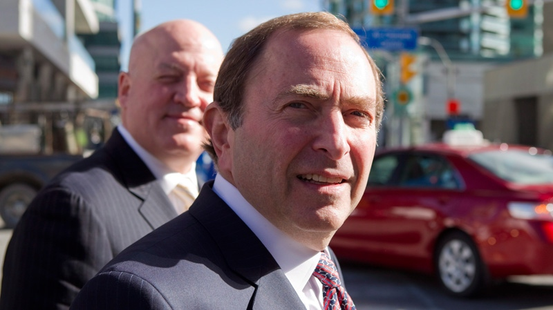 NHL Commissioner Gary Bettman (right) arrives with Assistant Commissioner Bill Daly for collective bargaining talks in Toronto on Wednesday, Oct. 16, 2012. (Chris Young / THE CANADIAN PRESS)
