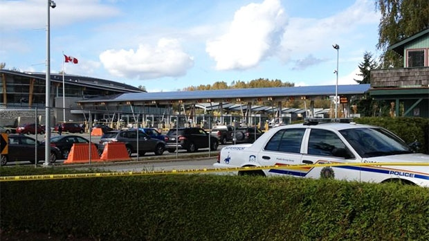 A police vehicle is seen at the Douglas border crossing in Surrey, B.C., after Canadian Border Services Agency agent was shot on Tuesday, Oct. 16, 2012. (Lisa Rossington / CTV News)