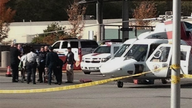 A Canadian Border Services Agency agent is transported after being shot at at the Douglas border crossing in Surrey, B.C. Tuesday, Oct. 16, 2012. (Lisa Rossington / CTV News)