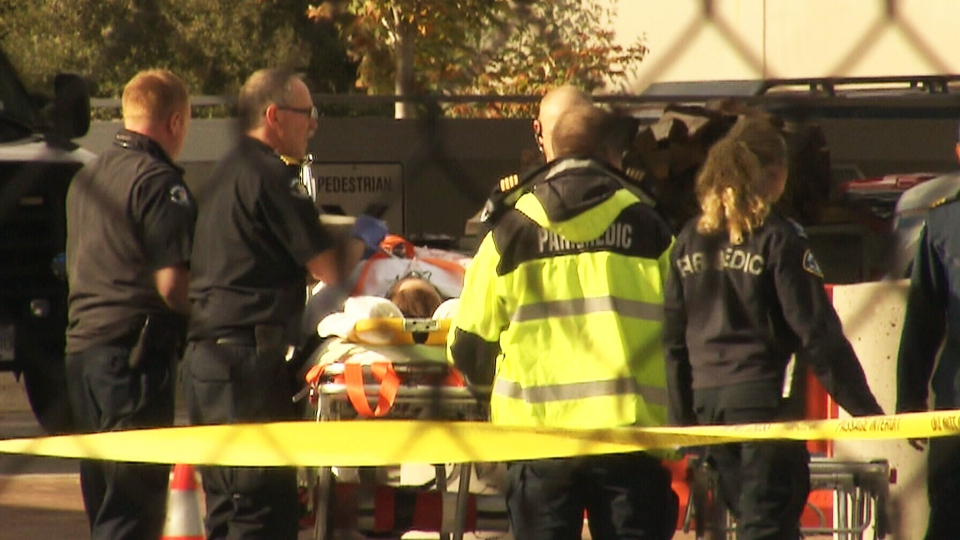 A Canadian Border Services Agency agent is transported after being she was shot at at the Douglas border crossing in Surrey, B.C. Tuesday, Oct. 16, 2012.