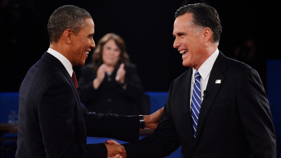Moderator Candy Crowley, centre, applauds as U.S. President Barack Obama, right, shakes hands with Republican presidential nominee Mitt Romney during the second presidential debate at Hofstra University, in Hempstead, N.Y., on Tuesday, Oct. 16, 2012. (AP /Pool-Michael Reynolds)