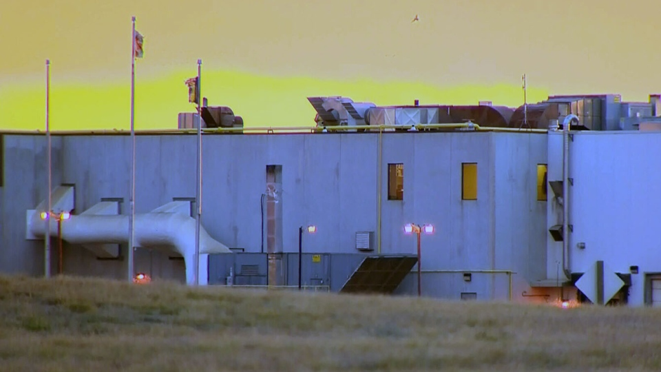The sun rises behind the XL Foods plant in Brooks, Alta., Tuesday, Oct. 16, 2012. (CTV Calgary)