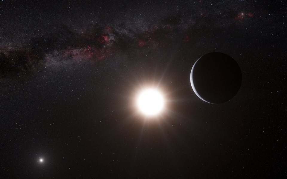 This artist's impression made available by the European Southern Observatory shows a planet, right, orbiting the star Alpha Centauri B, centre, a member of the triple star system that is the closest to Earth.