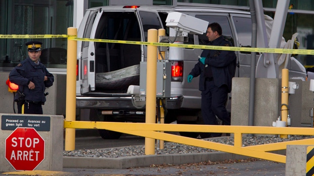 Police investigate at the scene of a shooting at the Canadian border crossing in Surrey, B.C., on Tuesday, Oct. 16, 2012. (Jonathan Hayward / THE CANADIAN PRESS)