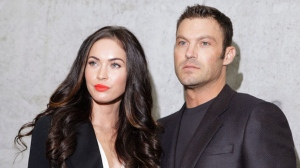 This Sept. 25, 2010 file photo shows American actress Megan Fox posing with her husband Brian Austin Green after watching the presentation of the Emporio Armani Spring-Summer 2011 fashion collection, during the fashion week in Milan, Italy. (AP Photo/Luca Bruno)